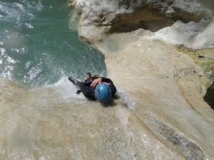 The first slide of the descent while canyoning in Riolan - French riviera