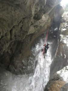 You'll first abseil down and then slide to the water! Canyoning in Riolan 06