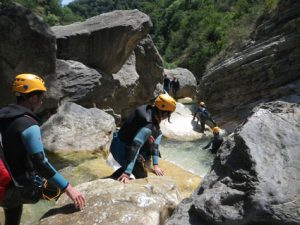 Walking in the river, one of canyoning techniques